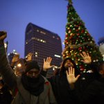 Hundreds of #ferguson protesters now disrupting Seattle tree lighting. Some shooting fireworks. #MikeBrown http://t.co/fZiaZTlTaD