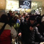 """Protestors storm Westlake mall, going up escalators. Now shouting """"these racist cops have got to go"""". http://t.co/ZPGqJrNErC"""