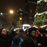 """""""This protest is not a riot."""" Protestors now back outside by Christmas tree. http://t.co/mIbKoleUgM"""