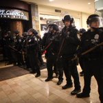 Seattle Police have followed protesters from Westlake Mall. Now outside. #Ferguson #MikeBrown http://t.co/loUbt0cdtU