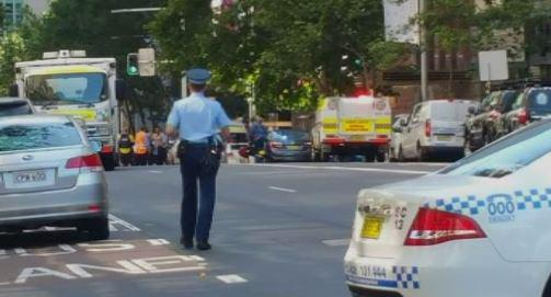Reports there are 13 hostages inside the Lindt café in Sydney's Martin Place: http://t.co/eMhyprDkiw http://t.co/JlOQ37rSk2