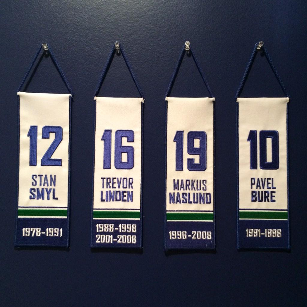 """Retired @VanCanucks jerseys now hanging from the """"rafters"""" in my room. #Steamer #CaptainCanuck #Nazzy #RussianRocket http://t.co/tLxrKsIM3O"""
