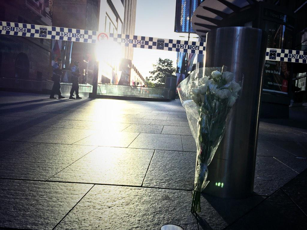 Flowers left at Martin Place this morning. http://t.co/dVLNm0vP0P