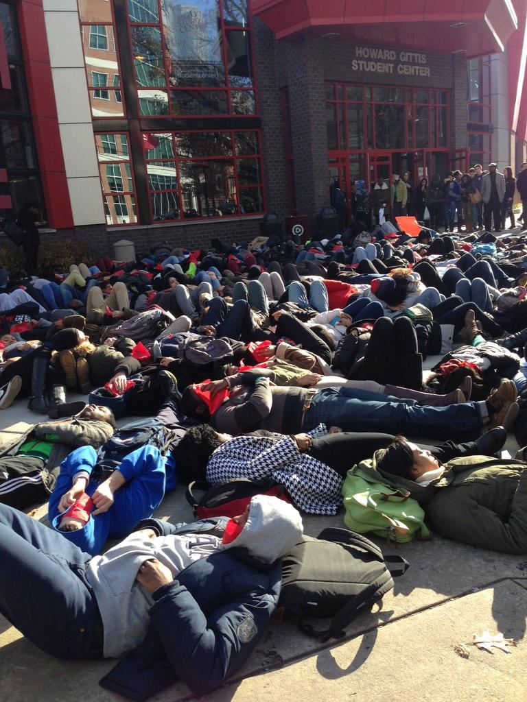 Students now laying on the ground in front of the student center #temple #EricGarner #MikeBrown @6abc http://t.co/WnPv05UOmM