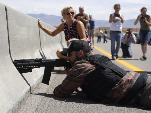 I'm pretty sure stealing taxpayer resources and aiming a high powered rifle at cops counts.  #CrimingWhileWhite http://t.co/Cgt3dkYfz8