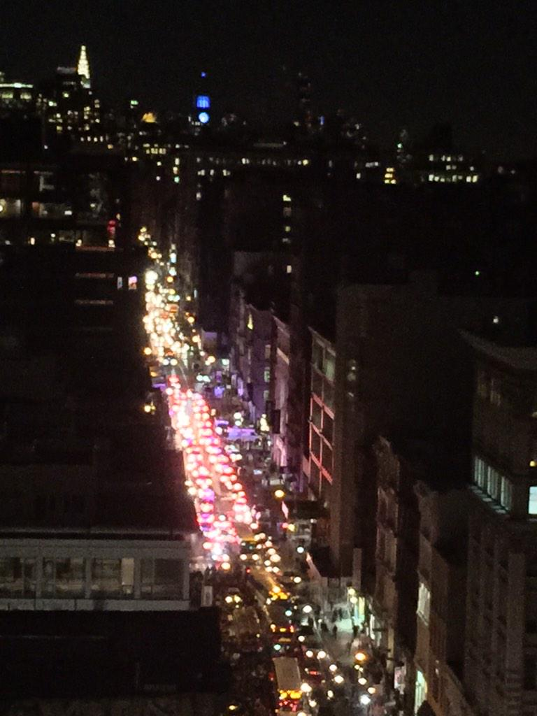 Those red lights up the street are ALL NYPD cars. Must be hundreds. http://t.co/68W2SwW218