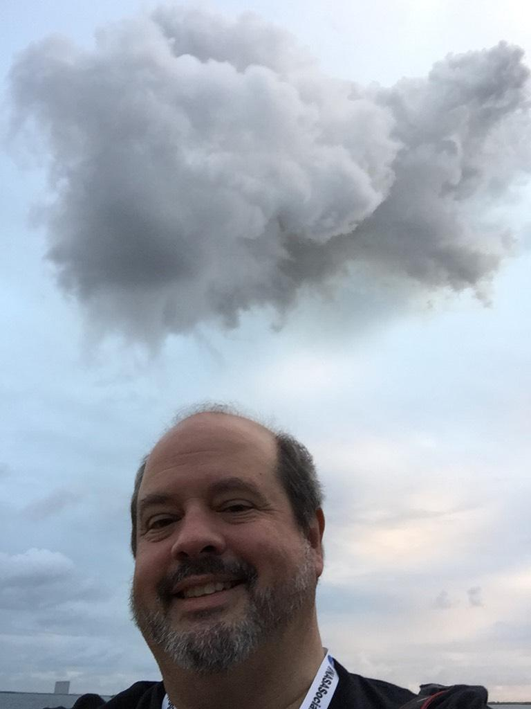 #Orion is on the way! That's the cloud formed by the launch plume behind me. http://t.co/WZzHGuW8Hy