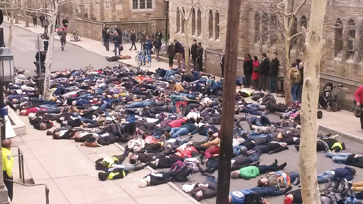 Students and community members lie down during the #YLSDieIn as a show of solidarity with demonstrations nationwide. http://t.co/my7WkOSm56