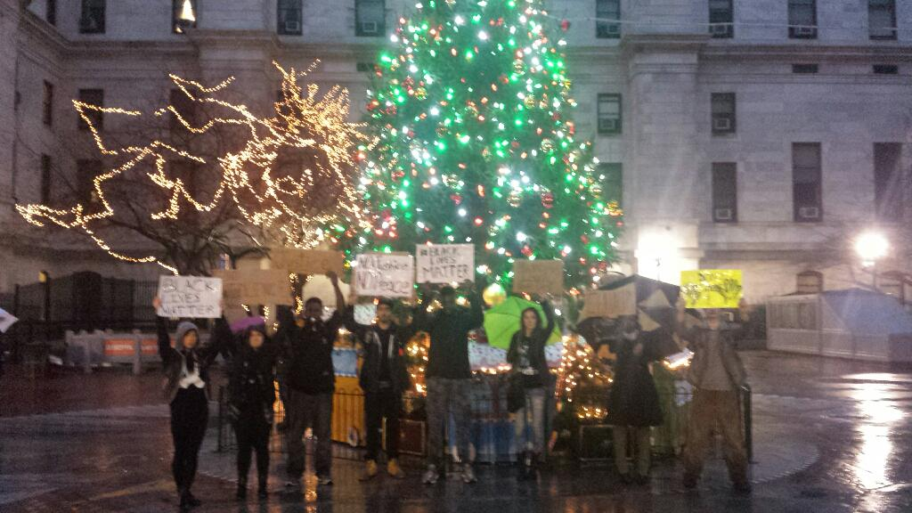 Deck the halls #PHLferguson #shutitdown #blacklivesmatter at Philly city hall tonight. Next: 7pm s st. Police http://t.co/AYURKvwLIe