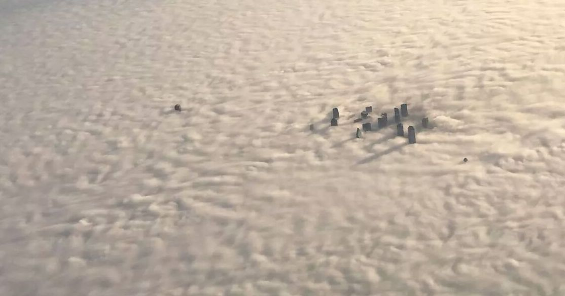 Whoa! That's not snow - that's Dallas covered in fog as seen from the air. http://t.co/jpyxb5KErn (via @AriWeather via @DMNBiz)