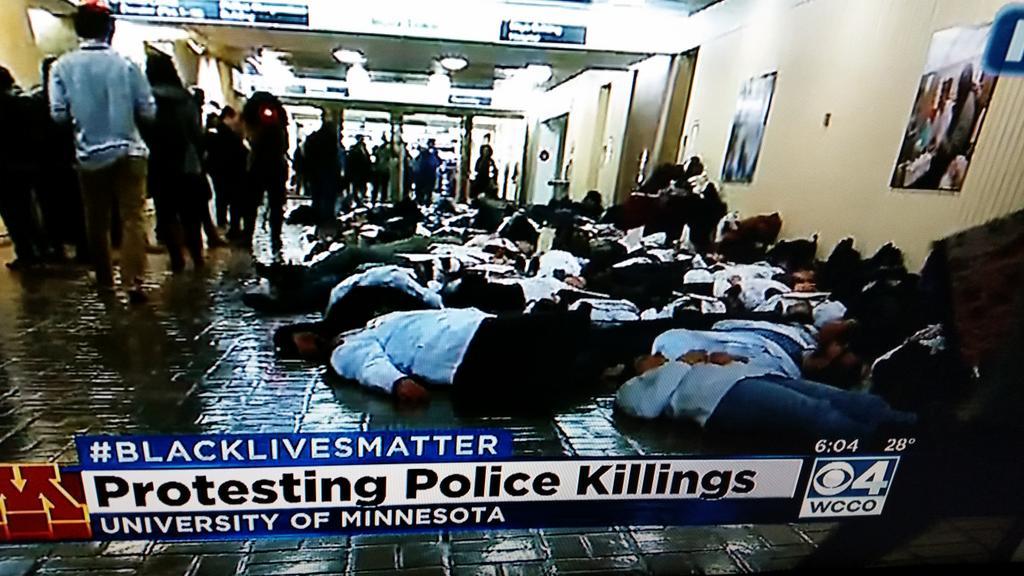 University of #Minnesota Med Students Do #DieIn Today.  #EricGarner #BlackLivesMatter #WhiteCoats4BlackLives http://t.co/EIEUHZ0pOZ