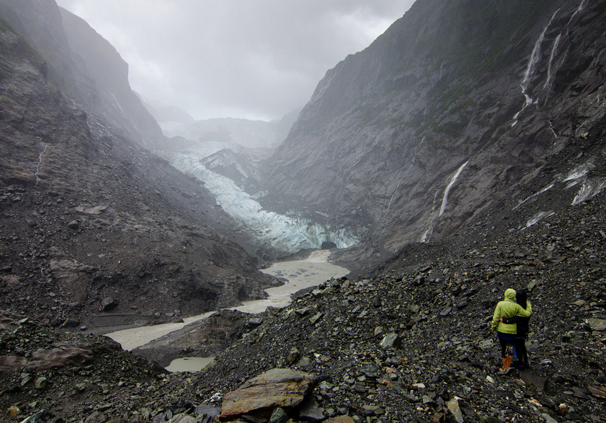 Hike through the rain during a storm at Franz Josef Glacier in New Zealand.
