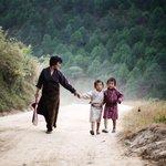RT @MyBhutan: A mother and her children walking a dirt road in Punakha. #MyBhutan #Bhutan #travel #asia #punakha #MarquandMondays