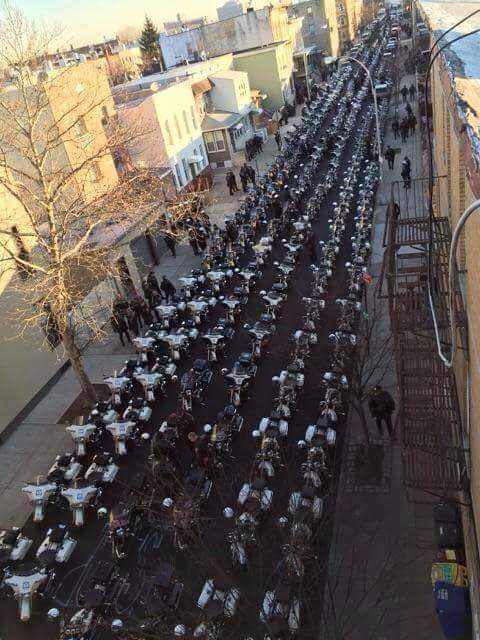 NOW THIS IS WHAT RESPECT IS: : #NYPD OFFICER RAMOS FUNERAL: http://t.co/3jICJd6YXi