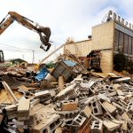 Excavator operator Cassie Steffen knocks down Crescent Cleaners for the I-74 bridge project in Bettendorf, Iowa. http://t.co/t2xp4IQ5xQ