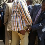 Senator Muthama displays injury & torn clothing after being roughed-up at parliament via @enocksikolia #SecurityBill http://t.co/oAkucKH7Em