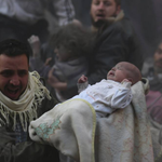 A man carries a baby away from the scene of an airstrike in Syria. The year in photos: http://t.co/XK96o3YEvP http://t.co/xWLKWKE9yE