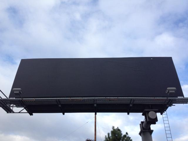 Yesterday this was a billboard advertising The Interview. Today ... http://t.co/P2goLIZDzk