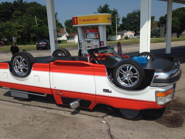 Look closer. Someone made this car *look* like it's upside down. http://t.co/TqXNpDeaXC