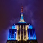 Our lights continue to shine in blue & white with a yellow candle antenna in honor of Hanukkah. #NYC http://t.co/NpnnnvTH29