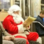 Santas checking it twice on the subway. #mta #nyc http://t.co/bKVyD0VYLL