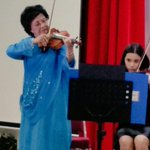 "Guest of honour Tun Dr Siti Hasmah plays ""The Moon Represents My Heart"" on the violin. @netraKL yr mum did us proud! http://t.co/g8dzSYhv1g"