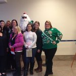 The trip central team poses with #Santa at @flyyhm http://t.co/VRnH3FPsug