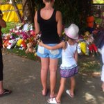 Dozens of bouquets, messages from pencils held by little hands, sets of eight candles at Murray St, Manoora, Cairns http://t.co/sICrM8CUrR