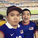 With my younger brother at Bukit Jalil National Stadium supporting #HarimauMalaya. @ivankang We do not look alike! http://t.co/pPpsrTn1zC