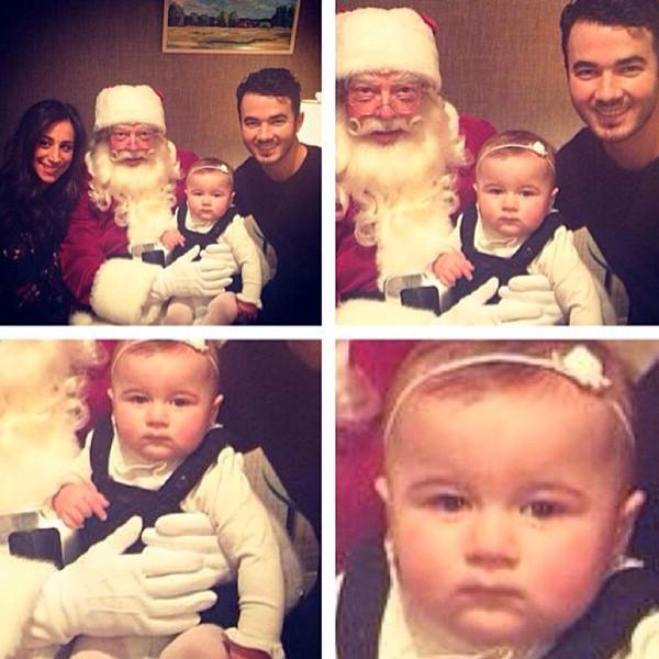 """This is the greatest """"not impressed by Santa face"""" we've ever seen:"""