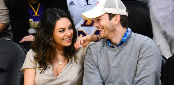 Mila Kunis & Ashton Kutcher are caught on a Kiss-Cam again! See the adorable pics!