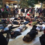 Protesters are now lying down in center court of @BellevueSquare http://t.co/ekf1naon2T