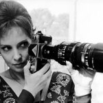 Italian actress and photojournalist Gina Lollobrigida holding a Nikon F and fast 180mm f/2.5 telephoto lens. http://t.co/G8cGFco2vm