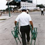 With the remains of old Comiskey in the background, a fan leaves with 2 seats bought for $50 each. #WhiteSox #Chicago http://t.co/65ctSjCb7t