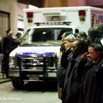 Police salute ambulances carrying the bodies of two NYPD officers killed Saturday in Brooklyn http://t.co/677wKKj9Er http://t.co/67aYFRtW43