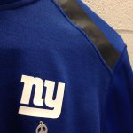 Tom Coughlin wearing a black strip on left shoulder and peace sign under NY in honor of #NYPD officers Liu and Ramos http://t.co/yr6tshDCTr