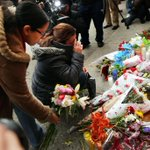 A city in mourning: condolences for fallen officers flood streets http://t.co/RUFpW7tgR0 http://t.co/dY9q5WpchP