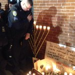 NYPD officers pay their respects to their fallen brothers http://t.co/Wx9Vsxf3sL