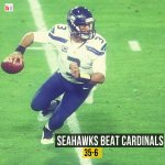 Seahawks blow out Cardinals and the No. 1 seed in the NFC is up for grabs! Russell Wilson 427 total yards, 3 TDs http://t.co/8wKSRQEmM1