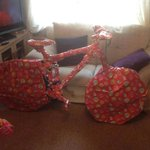 Smh how do you even wrap a bicycle? Im sure the recepient will be dying to unwrap this obviously hidden gift http://t.co/lhVkzgJ803