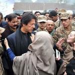 Imran khan talking to parents of martyres at Army Pubic School Peshawar #PeshawarAttack http://t.co/iRN68302dk
