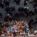 A memorial for two fallen police officers in Brooklyn. (Photo: Robert Stolarik for NYT) http://t.co/wNAnjyLtjg