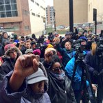 Large crowd Gathering at the federal courthouse with fists in the air. #DontreHamilton http://t.co/4KArbiKz4B