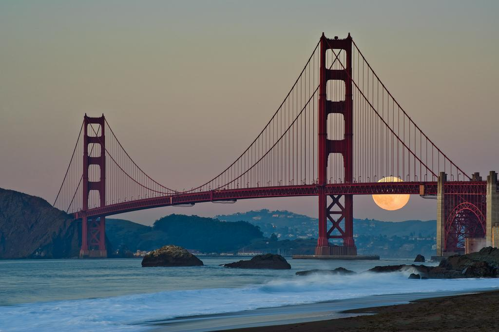 Full moon behind the Golden Gate Bridge. Photo by Howard Ignatius. http://t.co/P0w3ppTAwB