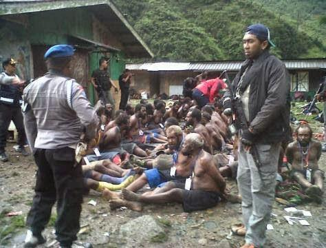 West Papuans stripped, tortured and arrested with their houses burned down. All by the Indonesian police. #Genocide http://t.co/Z6gqucColE