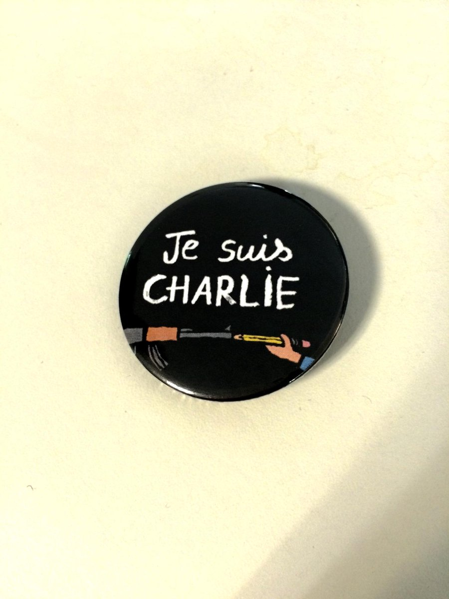 Making badges of solidarity in the WOLO office, featuring the great illustration from Jean Julien #jesuischarlie http://t.co/fWVNASarYS