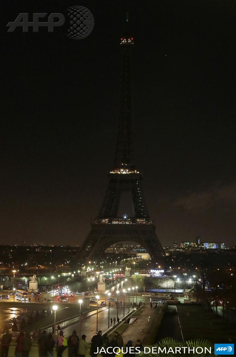 """""""@sbeaugeAFP: #EiffelTower goes dark in tribute to attack victims. Photo: Jacques Demarthon/AFP #JeSuisCharlie http://t.co/KoC89L0kS4"""""""