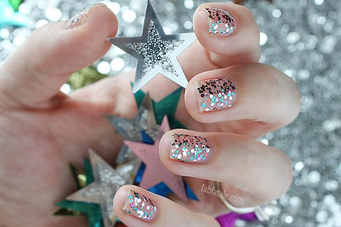 super festive New Year's Eve confetti nails featuring @essie, today at http://t.co/PlBWW3A5ND #nye #manimonday http://t.co/AXFXRNkbXV
