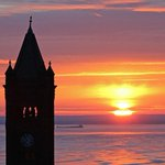 Freighters on Lake Superior & Old Central HS tower at sunrise in Duluth this morning http://t.co/KWmV3v7bLU
