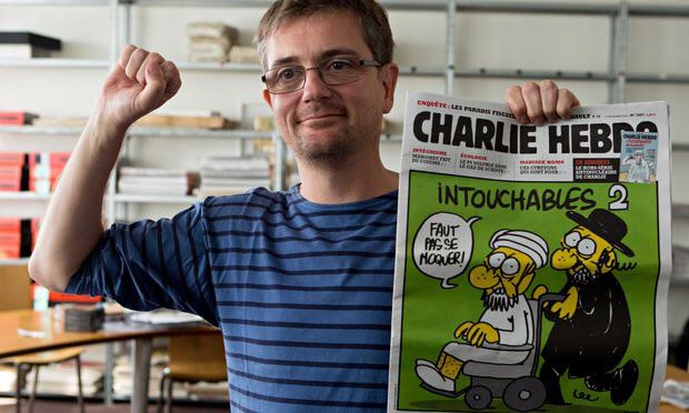#CharlieHebdo's publisher, Stephane Charbonnier, with one of the magazine's controversial covers. via @guardian http://t.co/zQiD005t46